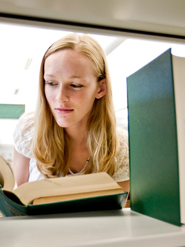 Girl looking at book
